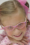 Pretty blond girl with pink sun glasses Stock Photography