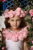 Pretty blond girl in a pink wreath of flowers Stock Photography