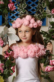 Pretty blond girl in a pink wreath of flowers Stock Photo