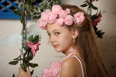 Pretty blond girl in a pink wreath of flowers Royalty Free Stock Photos