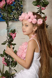 Pretty blond girl in a pink wreath of flowers Royalty Free Stock Images