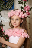 Pretty blond girl in a pink wreath of flowers Royalty Free Stock Photography