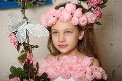 Pretty blond girl in a pink wreath of flowers Stock Images