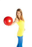 Pretty blond girl with red ball Royalty Free Stock Photos