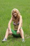 Pretty blond girl relaxing outdoor Royalty Free Stock Images