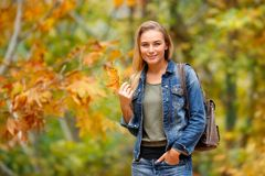 Pretty girl in autumn forest Royalty Free Stock Images