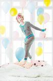 Pretty blond girl in the striped pajamas Royalty Free Stock Photos