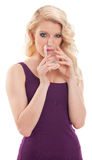 Pretty blond hair girl drinking water Royalty Free Stock Photos