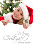 Pretty blond hair girl with santa hat Royalty Free Stock Photo
