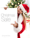 Pretty blond hair girl with santa hat Royalty Free Stock Photos