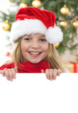 Pretty blond hair girl with santa hat and red comf Royalty Free Stock Photo