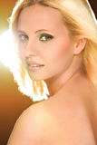 Pretty blond hair woman in flash lights. Retouched. Portrait of blond hair woman in flash lights. Retouched royalty free stock photos