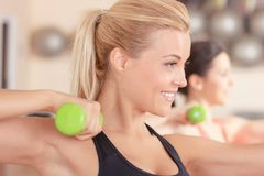 Pretty blond-haired woman doing fitness exercises Stock Photo
