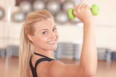Pretty blond-haired woman doing fitness exercises Royalty Free Stock Photography