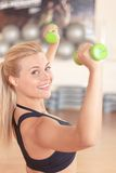 Pretty blond-haired woman doing fitness exercises Royalty Free Stock Image