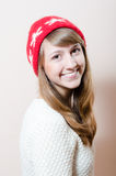 Pretty blond happy woman wearing knitted hat Stock Photos
