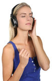 Pretty Blond Lady Music Listener Royalty Free Stock Photography