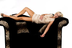 Pretty Blond Laying On Couch Royalty Free Stock Photo