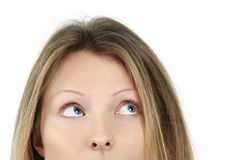 Pretty blond looking up Stock Photo