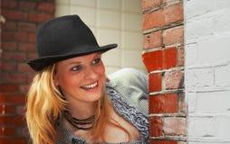 Pretty blond peeking stock photography
