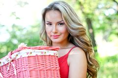 Pretty blond with pink basket Stock Image