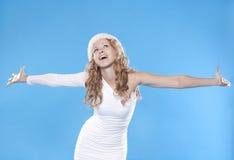 Pretty blond Santa girl Stock Images