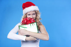 Pretty blond Santa girl with a present gift Stock Photos