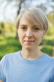 Pretty blond with short cut smiling. Pretty blond portrait with short cut smiling stock photo