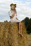 Pretty blond sit on haystack. Pretty girl sit on haystack Royalty Free Stock Images