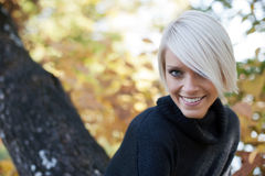 Pretty blond student in a fall garden Royalty Free Stock Photo