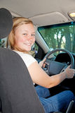 Pretty Blond Teen Driving Stock Photo