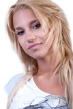 Pretty blond teen girl with noise ring. Pretty blond teen girl with long hair and noise ring, wearing white shirt, isolated on white. The model looking at the Stock Image