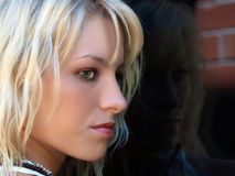 Pretty blond teen profile portrait outdoors window Royalty Free Stock Photography