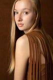 Pretty Blond Teen in Tasseled Shirt Stock Photo