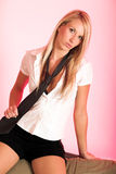 Pretty blond with tie. Jeanne-Marie sitting very seductive with tie in hand Stock Photography