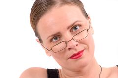 Pretty blond with tight hairdo and glasses. Sophisticated beauty on white background Stock Photography