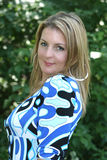 Pretty blond woman. An outdoor portrait of a pretty blond woman wearing a bright, colorful blue print blouse Royalty Free Stock Image