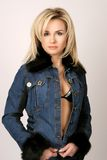 Pretty blond woman. A beautiful blonde woman in a jean jacket with fur Royalty Free Stock Photography