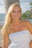 Pretty Blond Woman. In the tropics wearing a white dress Stock Photography