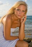 Pretty Blond Woman. In the tropics wearing a white dress Royalty Free Stock Photography