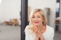 Pretty blond woman with a beaming smile Royalty Free Stock Photography