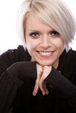 Pretty blond woman with a beaming smile. Pretty blond woman with a short modern hairstyle and a beaming smile looking directly into the camera, on white royalty free stock images
