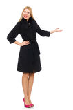 The pretty blond woman in black coat isolated on white Stock Image