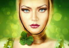 Pretty blond woman with blue eyes Royalty Free Stock Images