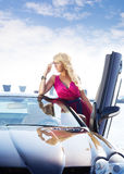 Pretty blond woman and car Stock Image
