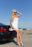 Pretty blond woman and car Royalty Free Stock Photos