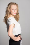 Pretty blond woman with curly hair Royalty Free Stock Photos