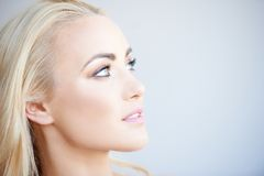 Pretty blond woman daydreaming Stock Photos