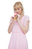 Pretty blond woman drinking cocktail and looking at camera Stock Image