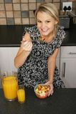 Pretty Blond Woman Eating Breakfast Stock Photo